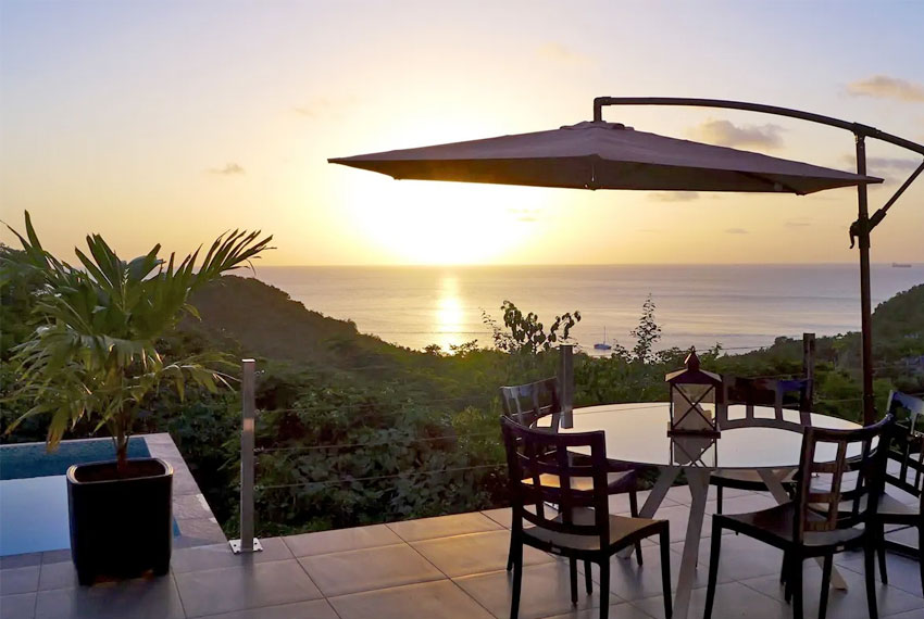 St-Lucia-Homes---GRI005-Lab-Villa---Outdoor-Dining-sunset-view